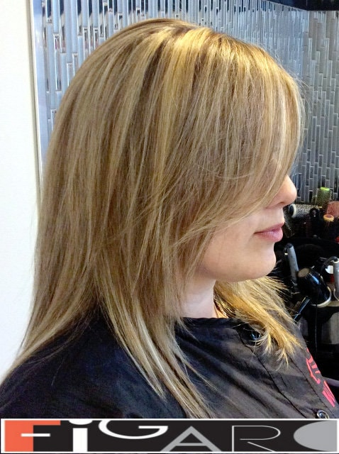 Layered medum length haircut done by Elena Bogdanets Toronto